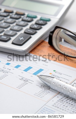 Stock chart with calculator,pen and eyeglasses - stock photo