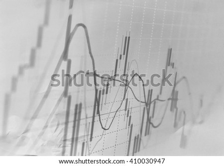 Stock exchange trade chart on paper background - stock photo