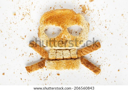 Stock image image of bread skull and crossbones with crumbs on white background - stock photo