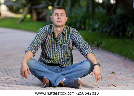 Stock image meditating man on a pathway - stock photo