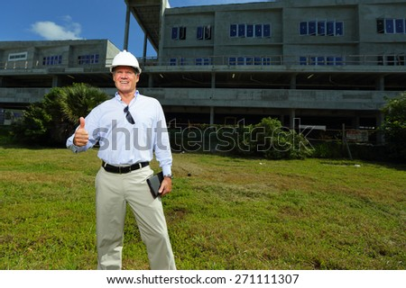 Stock image of a construction professional showing a thumbs up gesture - stock photo