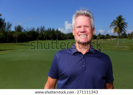Stock image of a golfer with a cheesy grin - stock photo