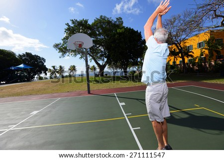 Stock image of a senior making a basketball shot - stock photo