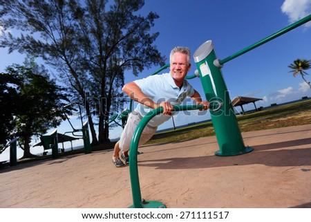 Stock image of a senior man doing pushups - stock photo