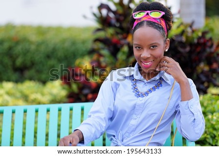 Stock image of a woman sitting and smiling at camera - stock photo