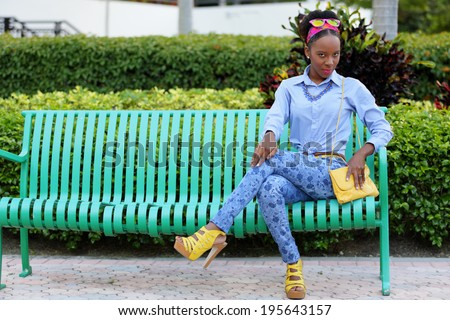 Stock image of a woman sitting with legs crossed - stock photo