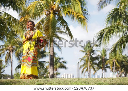 Stock image of an African American woman wearing traditional African clothing - stock photo