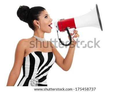 Stock image of bossy woman in formalwear using bullhorn over white background - stock photo