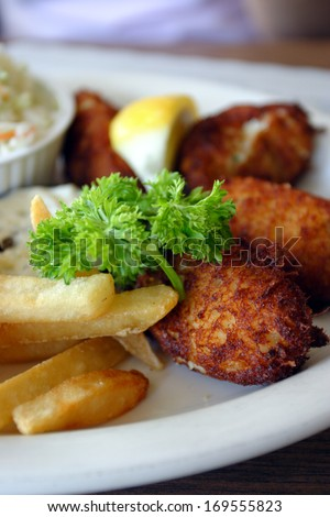 Stock image of breaded scampi tails with salad leaves   - stock photo