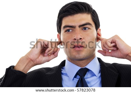 Stock image of businessman covering his ears with his hands, over white background - stock photo