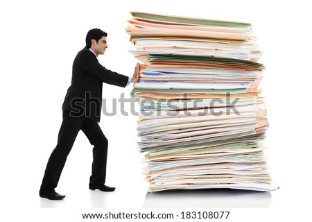 Stock image of businessman pushing a giant stack of documents isolated on white background - stock photo