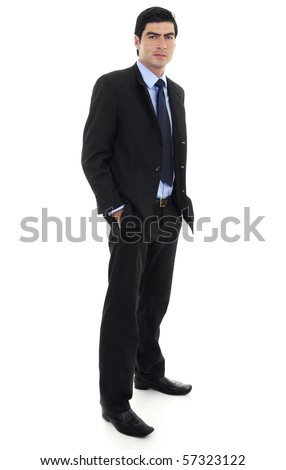 Stock image of businessman standing with arms on pockets over white background. Full body shot. - stock photo
