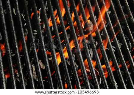 Stock image of charcoal fire grill, close up with live flames - stock photo