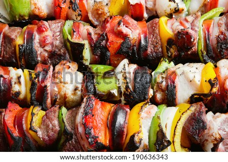 Stock image of close up of grilled beef and chicken kebabs - stock photo