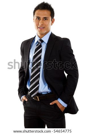 Stock image of hispanic businessman standing with hands in pockets over white background - stock photo