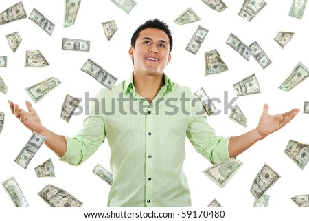 Stock image of money falling around young man - stock photo