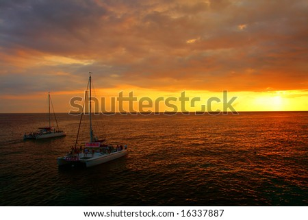 Stock image of sunset over Caribbean sea as view from Rick's Caf?, Negril, Jamaica - stock photo