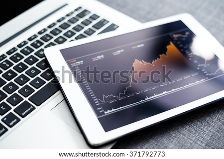 Stock market chart on digital tablet pc - stock photo