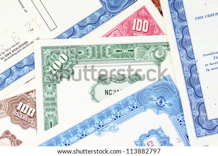 Stock market collectibles. Old stock share certificates from 1950s-1970s (United States). Vintage scripophily objects (obsolete). - stock photo