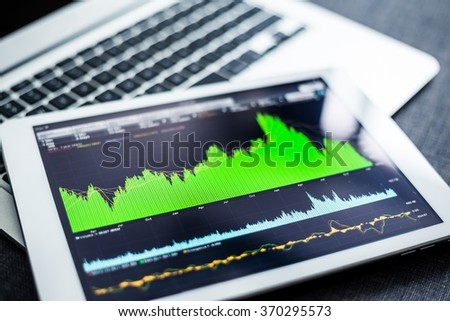 Stock market data on tablet pc - stock photo