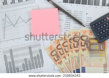 Stock market, finances, business and money concept - calculator, pen and 50 euro banknotes over stock quotes and charts with pink sticker space for text message - stock photo