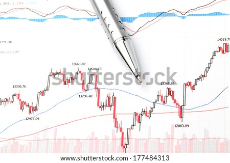 Stock market graph and pen - stock photo