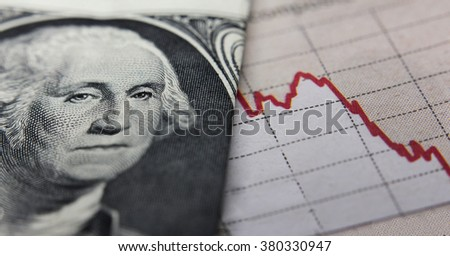 Stock Market Graph next to a 1 dollar bill (showing former president Washington). Red trend line indicates the stock market recession period - stock photo
