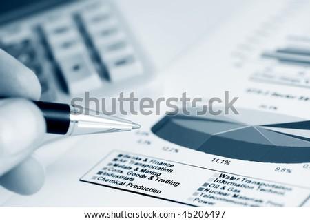 Stock market graphs analyzing. - stock photo