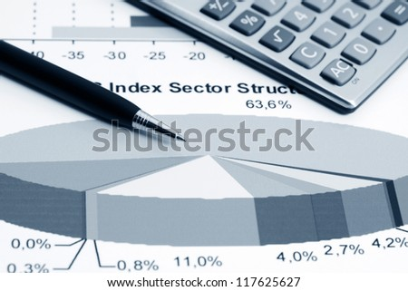 Stock market graphs and calculator - stock photo