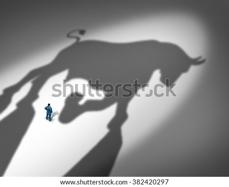 Stock market growth indicator and financial business trend concept as the cast shadow of a bull looming over a businessman as a profit and positive forecast signal for future investment success. - stock photo