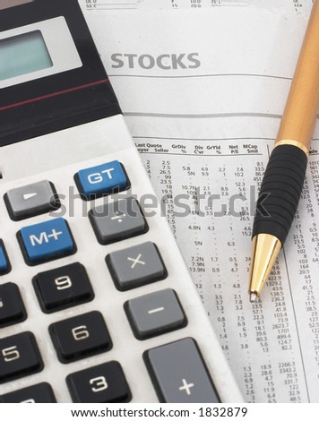 Stock market table analysis, calculator and pen indicates research and analysis, vertical orientation - stock photo