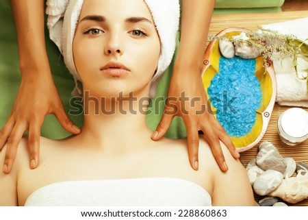 stock photo attractive lady getting spa treatment in salon, close up asian tan hands on face - stock photo