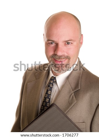 Stock photo of a well dressed businessman holding a notebook, isolated on white. - stock photo