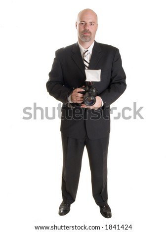 Stock photo of a well dressed wedding photographer.  Full length, isolated on white. - stock photo