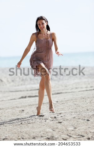 Stock photo of a woman jumping on the sand - stock photo
