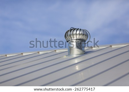 Stock photo of an attic vent on a freshly installed, brand new metal roof at a residential home. - stock photo
