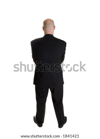 Stock photo of the back side of a well dressed businessman facing away from the camera.  Full length, isolated white. - stock photo