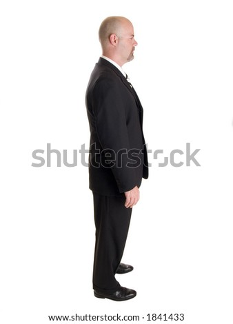 Stock photo of the side view profile of a well dressed businessman.  Full length, isolated white. - stock photo