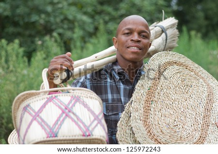 Stock photograph of a black South African entrepreneur small .business broom salesman in Hilton, Pietermaritzburg, Kwazulu-Natal - stock photo