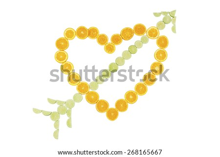 Stock picture of sliced oranges and limes, forming a heart and an arrow, on a white background - stock photo