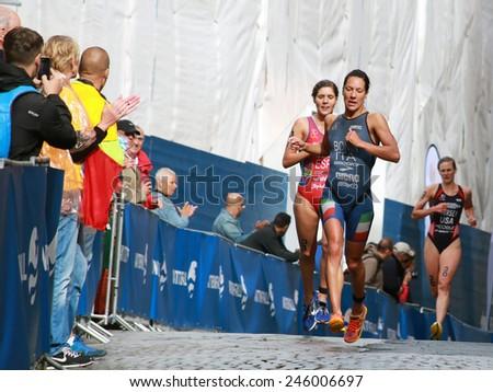 STOCKHOLM - AUG 23, 2014: Charlotte Bonin (ITA) one meter before Carolina Routier (ESP) in the Women's ITU World Triathlon series event Aug 23, 2014 in Stockholm, Sweden - stock photo