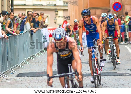 STOCKHOLM - AUG, 24: Cycling event of the Mens ITU World Triathlon Series event Aug 24, 2012 in Stockholm, Sweden - stock photo