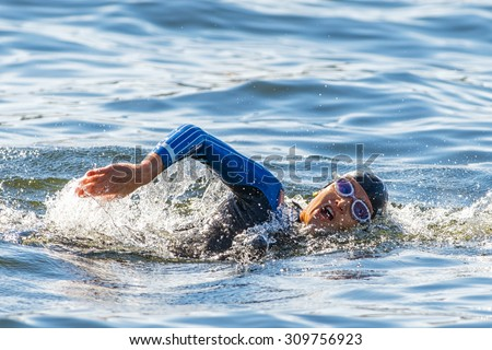 STOCKHOLM - AUG 22, 2015: Face of a female triathlete swimming at Womens ITU World Triathlon series event. - stock photo