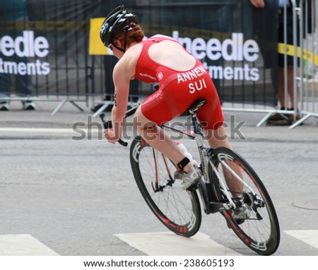 STOCKHOLM - AUG 23, 2014: Jolanda Annen (SUI) cycling in a curve in the Women's ITU World Triathlon series event August 23, 2014 in Stockholm, Sweden - stock photo