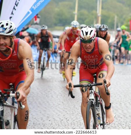 STOCKHOLM - AUG 23: Triathletes Francesc Godoy and Jesus Gomez cycling in the Men's ITU World Triathlon series event Aug 23, 2014 in Stockholm, Sweden - stock photo
