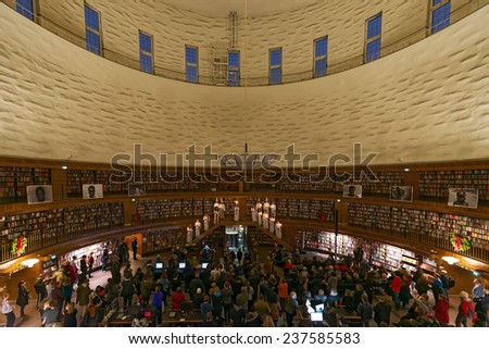 STOCKHOLM, DEC 13: Traditional Lucia celebration in the city library or Stadsbiblioteket with its rotunda at Observatorielunden. December 13, 2014 in Stockholm, Sweden. - stock photo