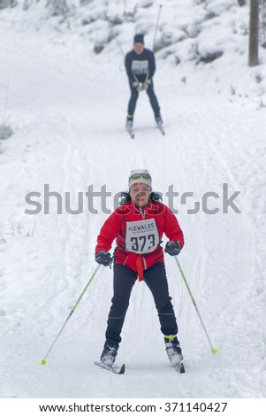 STOCKHOLM - JAN 24, 2016: Cross country skiing woman followed by a man at the Stockholm Ski Marathon event January 24, 2016 in Stockholm, Sweden - stock photo