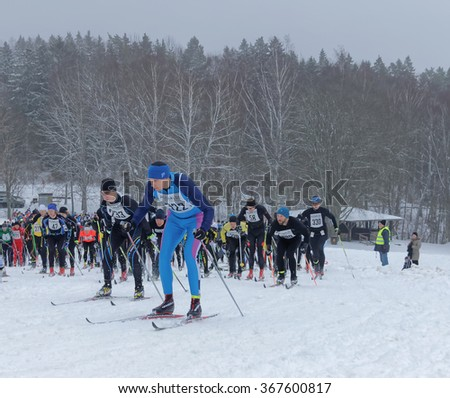 STOCKHOLM - JAN 24, 2016: Large group of fighting male cross country skiers after the start at the Stockholm ski marathon event January 24, 2016 in Stockholm, Sweden - stock photo