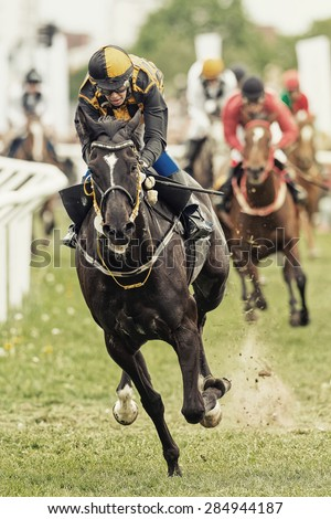 STOCKHOLM - JUNE 6: Action when jockey and horse coming out from the last curve at the Nationaldags Galoppen at Gardet. June 6, 2015 in Stockholm, Sweden. - stock photo