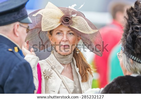 STOCKHOLM - JUNE 6: Traditional Hat parade before the horse racing competition at Nationaldags Galoppen at Gardet. June 6, 2015 in Stockholm, Sweden. - stock photo